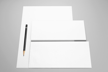Sheet of paper, envelopes, and pencil