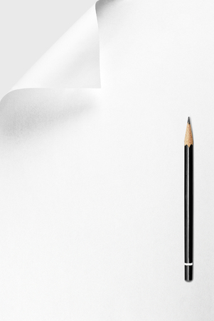 Blank sheet of paper with curled corner and pencil Stock Photo