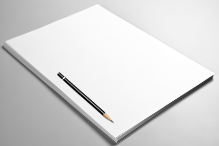 Heap of blank sheets of paper and a pencil Stock Photo