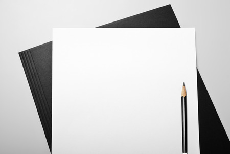 Folder with blank sheets of paper and pencil