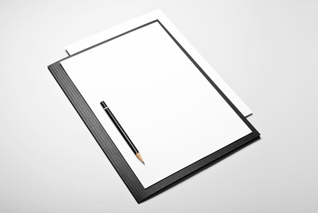Folder, blank sheets of paper, and pencil