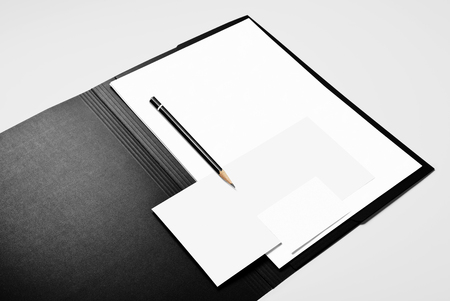 Folder, blank sheets of paper, pencil, and business card Stock Photo