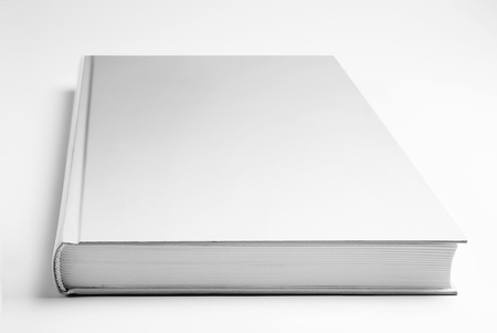 Blank closed book over gray background
