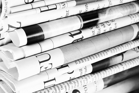 Stack of old folded newspapers as background Stock Photo