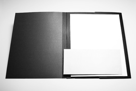 Folder, blank sheets of paper, and envelope Stock Photo