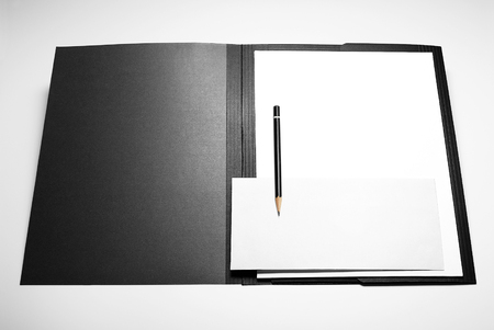 Folder, blank sheets of paper, envelope, and pencil