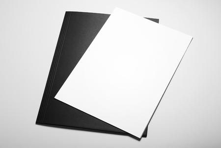 Blank sheets of paper over black folder