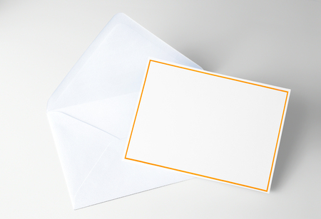 Blank card decorated with yellow frame and blue envelope Stock Photo