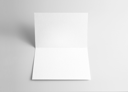 Blank open card over gray background Stock Photo