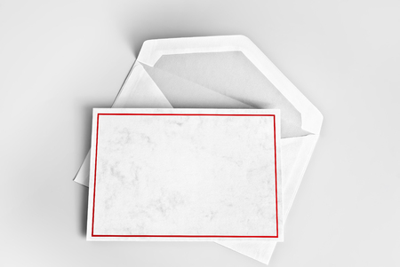 Blank greeting or thank you card with red frame over blank envelope Stock Photo