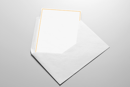 Blank greeting with golden frame in envelope