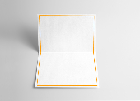 Blank folded thank you or greeting card with gold ribbon
