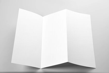 Blank Open Flyer, Folded Letterhead, or Letter Over Grey Background Standard-Bild