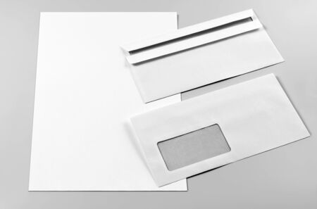 Blank Letterhead and Two Envelopes over Grey Background