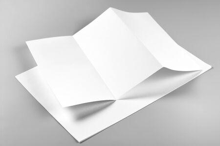 Blank Folded Flyer or Letterhead over Stack of Paper
