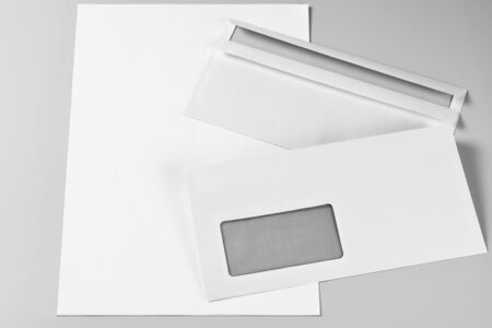 Two Envelopes over Blank Sheets of Paper