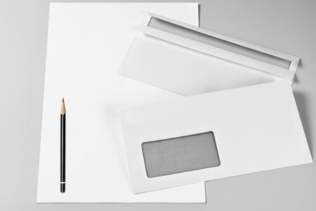 Blank Sheets of Paper, Two Envelopes, and Pencil Standard-Bild