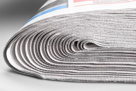 Stack of old rolled up newspapers