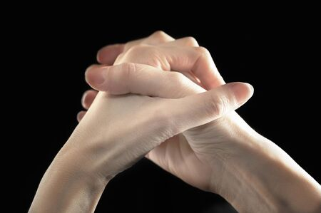 Close-up of two clasped hands