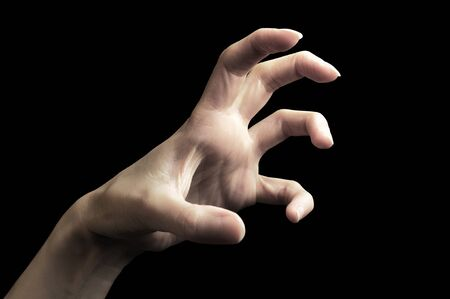 Scary hand gesture isolated on black