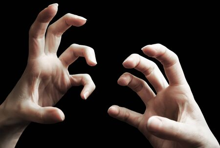 Scary two hands gesture isolated on black Standard-Bild