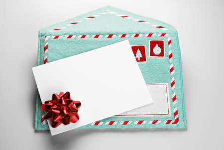 Christmas blank gift card over fabric embroidered envelope