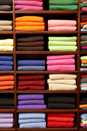 Piles of multicolored knitted woolen clothing  photo