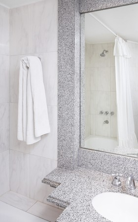 Modern bathroom part with mirror, towels, taps, shower and curtain photo