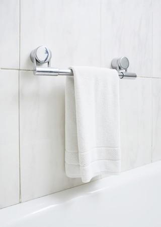 Modern bathroom part with white bath rug
