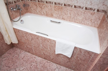The part of a bathroom with bath, tap, towel and other details  Stock Photo