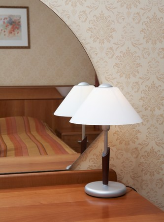 Lamp in front of mirror in a modern bedroom   photo
