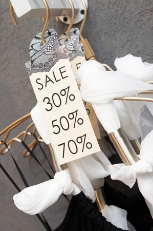 Sale labels on clothes hangers photo