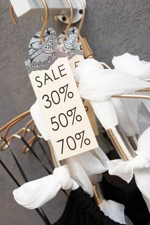 Sale labels on clothes hangers
