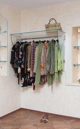 Lady clothing store interior with shelf photo