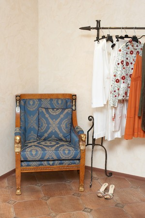 Lady clothing store interior with armchair photo