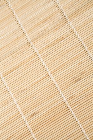 Bamboo mat with white threads texture in diagonal Standard-Bild