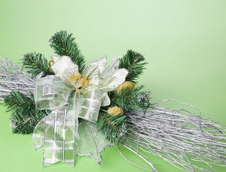Part of Christmas decoration flower on green background with place for your text photo