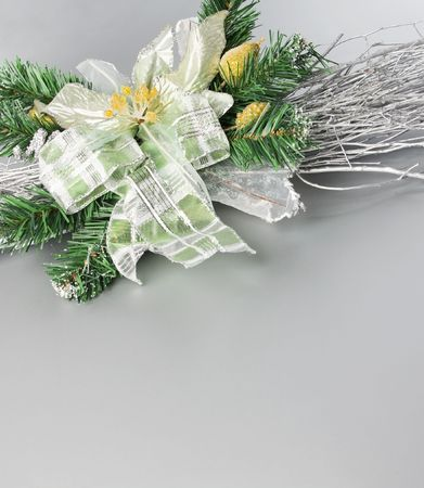 Part of Christmas decoration flower on gray background with place for your text photo