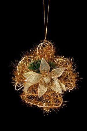 Christmas gold decoration angel on black background photo