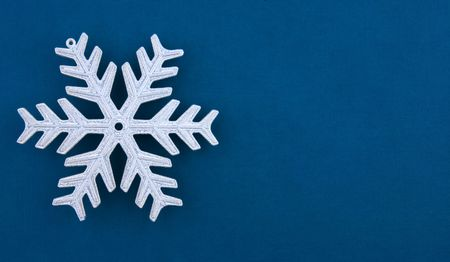 Christmas decoration silver snowflake on blue textured paper background. Useful for any type of Christmas card Stock Photo - 5950941