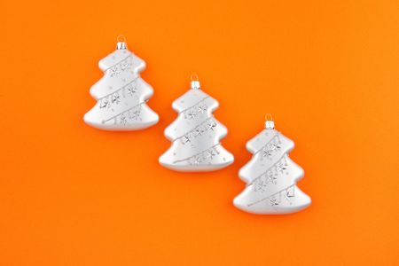 Three Christmas decoration silver firs on orange background. Modern Christmas card Stock Photo - 5950929