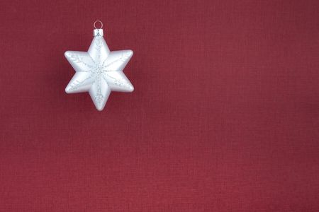 Christmas decoration silver snowflake on vinous textured paper background with space for your text photo