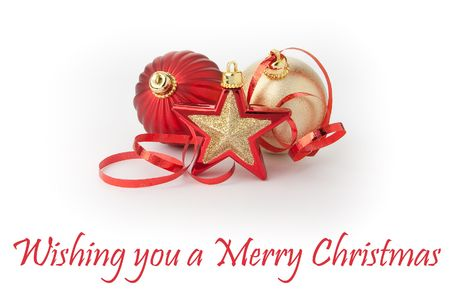 Christmas decoration balls and star red and gold with ribbon on white