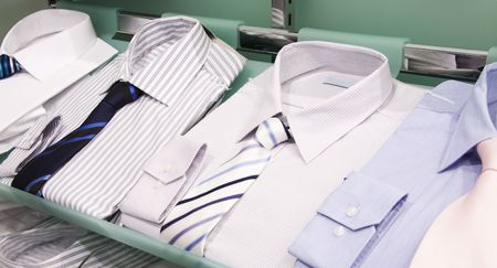 Shelves with men�s shirts in boutique Stock Photo