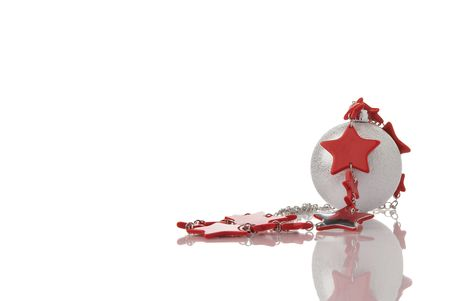 Christmas decoration silver ball with red stars garland on white background with reflection and empty space for your text Stock Photo - 6120109