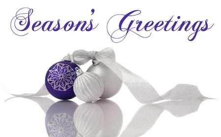 Christmas decoration lilac and silver balls with ribbon on white with reflection