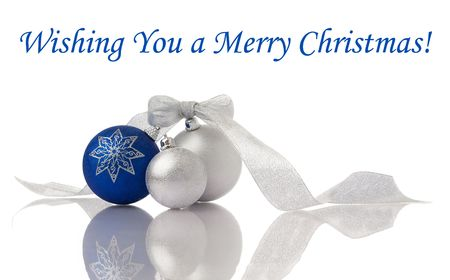 Christmas decoration blue and silver balls with ribbon on white with reflection photo