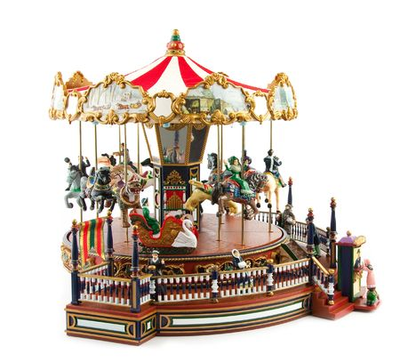 Merry-go-round toy on white photo