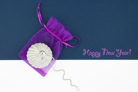 Christmas decoration silver ball with silver chain and lilac bag on blue and white background Stock Photo - 6173679