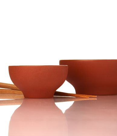 Emty asian ceramics bowls and wood chopsticks on white with reflection Stock Photo